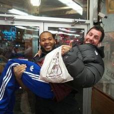 store guard holding Adam Sandler